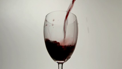 Pouring wine slow motion. Artificial slow motion.