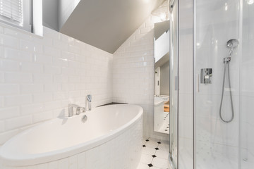 Bathtub in white bathroom