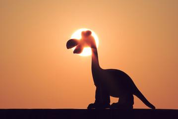 Dinosaur waiting for sunrise. Cartoon.