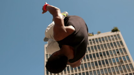 Handsome young man doing backflip