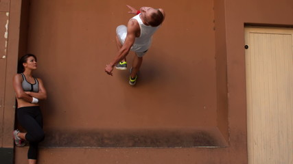 Young man doing a front somersault