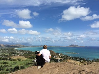 Man and his dog enjoy the view on the Lanikai Pillboxes hike
