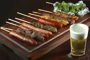 Barbecue beef, sausage, chicken served on a stick.