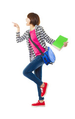 Young happy student holding books and showing something