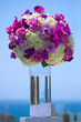Bouquet of flowers in clear glass vase outdoors