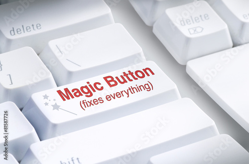 Leinwandbild Motiv Magic Button on computer keyboard which claims to Fix Everything