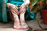 Indian hindu bride with mehendi heena on hands.