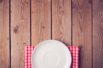 Mock up template with empty plate over wooden background