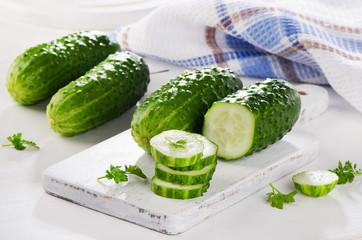 Fresh Sliced cucumber on a cutting board.