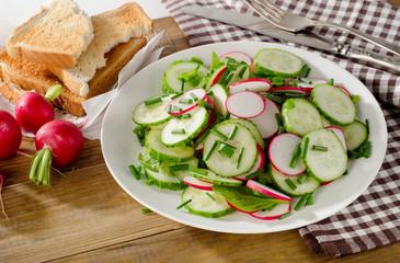 Salad with radish and cucumbers.