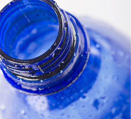 Plastic blue bottle of a drinking water .