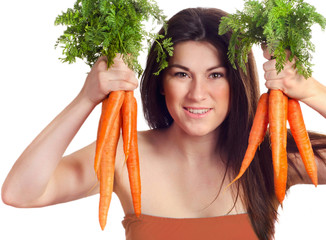 woman holds bunch of carrots