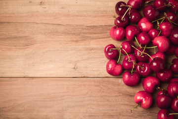 Food background with fresh cherries with retro filter