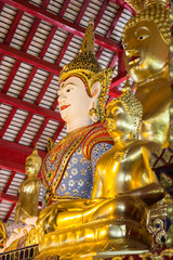 asian angel and golden buddha statue