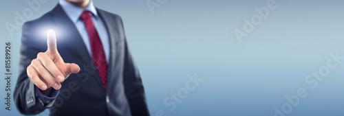 Leinwanddruck Bild Man with Touchscreen