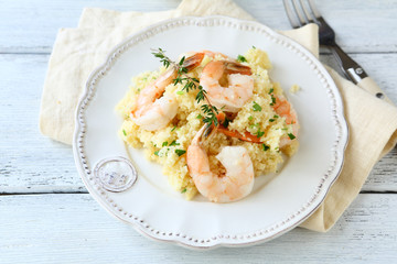 Couscous with seafood on a plate