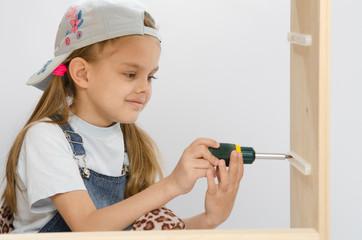 Child screwed fastening wooden cabinet