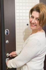Beautiful caucasian woman standing by  door