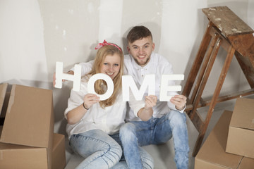 Happy young couple moving in their new home