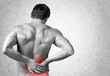 Ache. Rear view of a young man holding his back in pain - 81591157