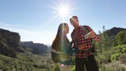 Happy couple taking selfie photo image hiking
