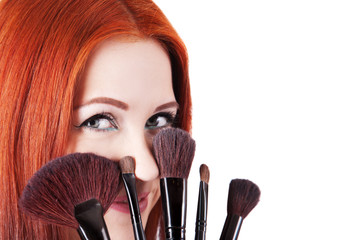 Girl makeup artist with brushes closeup