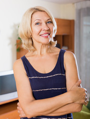 smiling mature woman  in home or office
