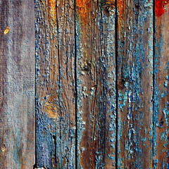 old wooden background with worn and cracked paint