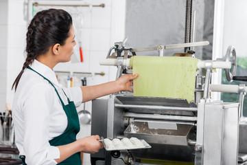 Chef Processing Ravioli Pasta In Machinery