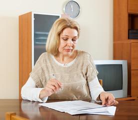 mature woman reading document