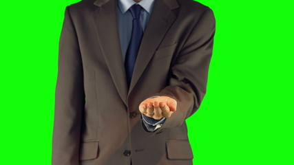 Businessman presenting with hand