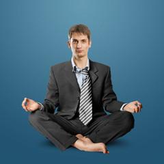 businessman in lotus pose