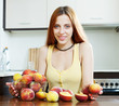 long-haired woman with peaches  in home interior