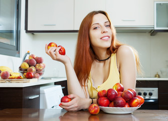 pretty  woman with nectarines