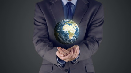 Businessman presenting earth with hands