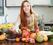Positive girl with ripe fruits