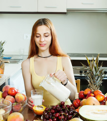 woman  drinking milk shake with fruits