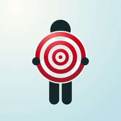 figure holding a red target