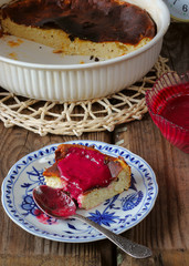 Sweet curd pudding with berry jam on a plate