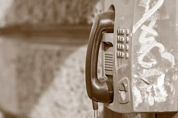 old payphone in tone sepia