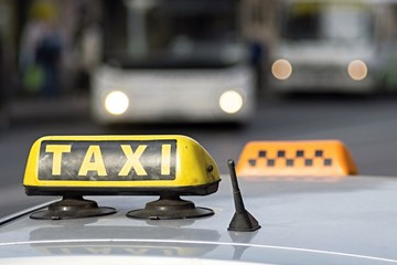 emblem taxi by car