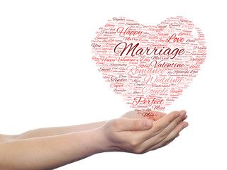 Conceptual Valentine heart word cloud in hands