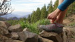 Hiker tying shoes on hike