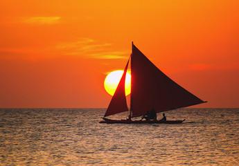 Sunset through the sailboat