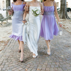 bride and bridesmaids with wedding bouquet
