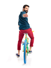 Man on colorful bike