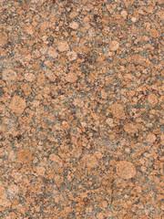 red-brown mottled granite texture