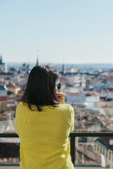 Woman looking the cityscape from the Terrace