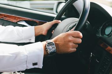 Man Driving a Luxury Car
