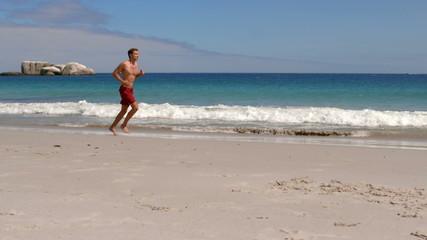 Handsome man running